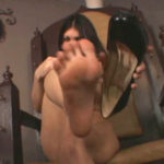 JADE INDICA – A cute, naked Jade sits above you while she describes to you how sweaty her feet are. She takes her stiletto off to smell her really stinky feet and lets you know how bad they smell. Jade would absolutely love to have a foot boy there to massage her pretty feet, to lick them and suck on them. Who's going to take the position of Jade's foot slave?