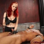 """MZ BERLIN – Mz. Berlin ties her slave down on his back and asks him about why he likes """"nipple torture"""", and then explains the difference between """"torment"""" and """"torture"""". She takes a mean rubber flogger and begins to beat his right nipple while he squirms and groans in pain. She attaches clover clamps to his nipples and then connects them to another pair on his balls. She sounds his cock with several metal sounds, of varying thicknesses, stretching his urethra"""
